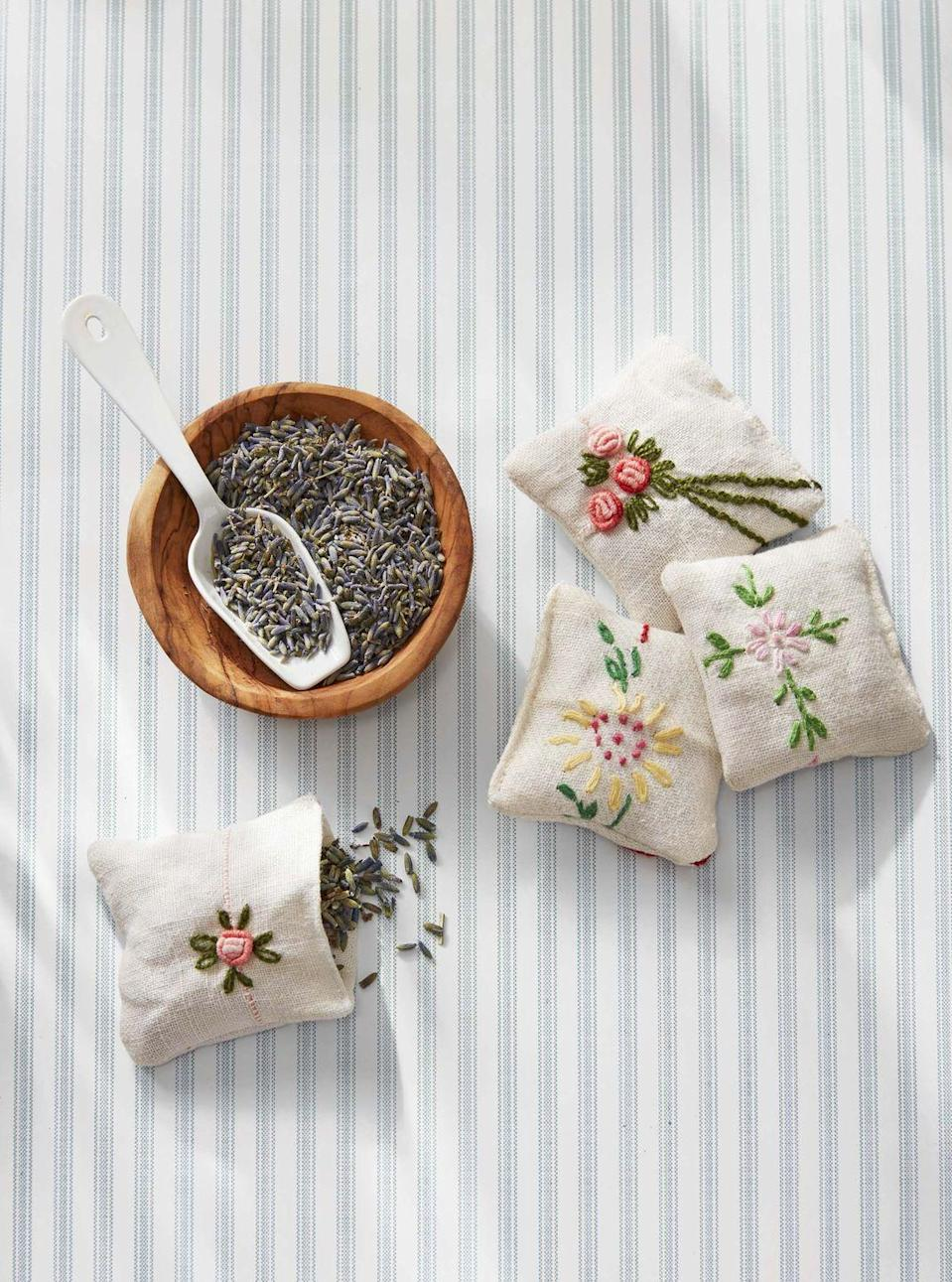 """<p>Mom will love a sweet-smelling lavender sachet to brighten up her purse or drawer. <strong><br></strong></p><p><strong>To make</strong>: Cut a 2-by-4-inch rectangle from a handkerchief. Fold in half crosswise with the pattern facing inward. Stitch two sides closed with a sewing machine; turn pouch right-side out. Fill with dried lavender. Hand-stitch opening closed.</p><p><a class=""""link rapid-noclick-resp"""" href=""""https://www.amazon.com/Organic-Lavender-Flowers-Extra-Grade/dp/B01BTNMGXU/ref=sr_1_1_sspa?tag=syn-yahoo-20&ascsubtag=%5Bartid%7C10050.g.2357%5Bsrc%7Cyahoo-us"""" rel=""""nofollow noopener"""" target=""""_blank"""" data-ylk=""""slk:SHOP DRIED LAVENDER"""">SHOP DRIED LAVENDER</a></p>"""