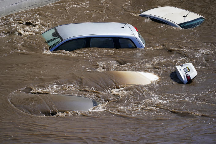 Vehicles are under floodwater from Schuylkill River in the Manayunk section of Philadelphia, Thursday, Sept. 2, 2021 in the aftermath of downpours and high winds from the remnants of Hurricane Ida that hit the area. (AP Photo/Matt Rourke)
