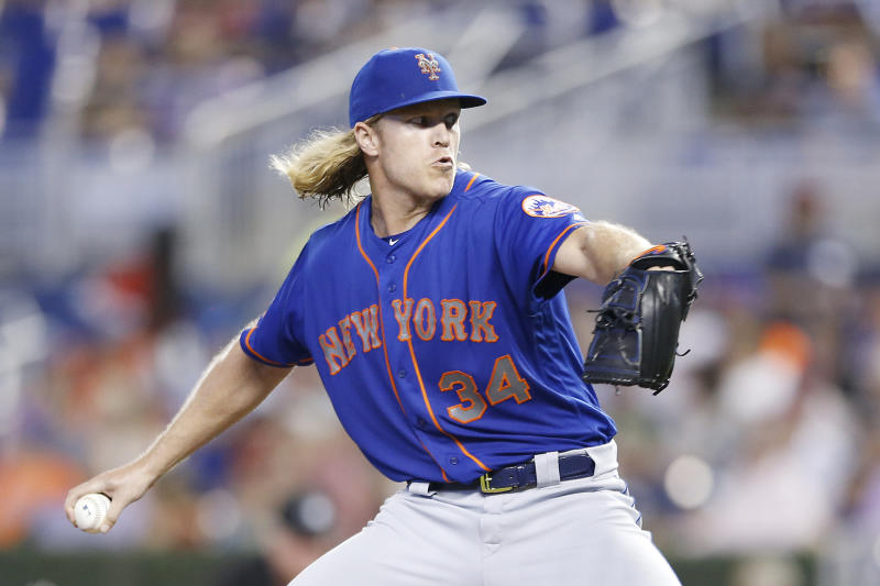 MIAMI, FLORIDA - JULY 13: Noah Syndergaard #34 of the New York Mets delivers a pitch in the first inning against the Miami Marlins at Marlins Park on July 13, 2019 in Miami, Florida. (Photo by Michael Reaves/Getty Images)