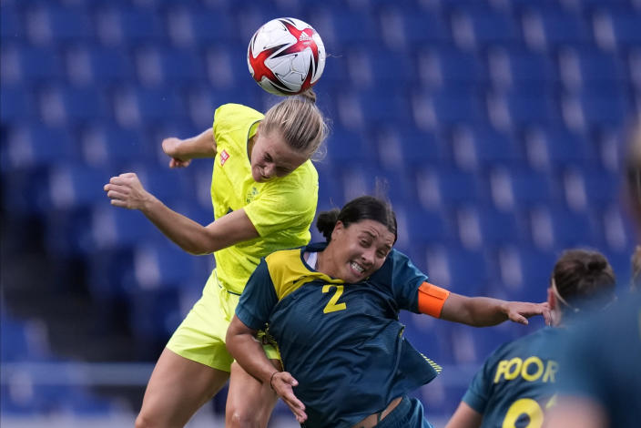 Sweden's Magdalena Eriksson goes for a header against Australia's Sam Kerr (2) during a women's soccer match at the 2020 Summer Olympics, Saturday, July 24, 2021, in Saitama, Japan. (AP Photo/Martin Mejia)