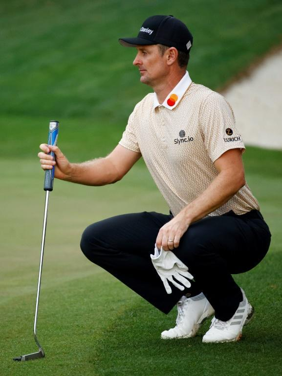 England's Justin Rose looks over a putt in the third round of the Masters on the way to an even par 72 that left him tied for second, four shots behind Hideki Matsuyama