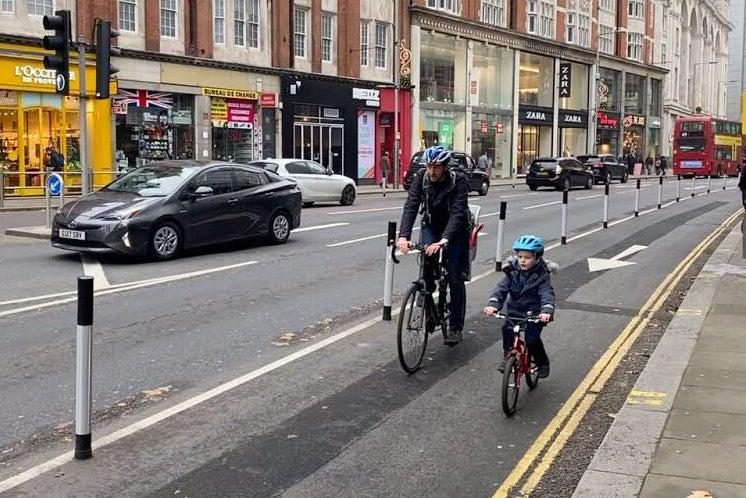 <p>Child's play: the segregated lanes mean children can ride on the street</p>Simon Still