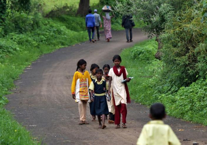 FILE PHOTO: Schoolchildren learn with the help of pre-recorded lessons in Dandwal village, Maharashtra