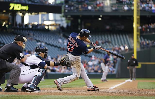 Cleveland Indians' Asdrubal Cabrera hits a sacrifice fly to score Michael Bourn (not shown) in the fifth inning of a baseball game against the Seattle Mariners, Saturday, June 28, 2014, in Seattle. (AP Photo/Ted S. Warren)
