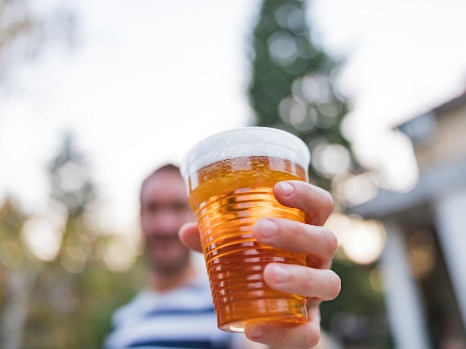 <p>Drinking alcohol in public outdoor spaces in mainland Scotland is now banned under new coronavirus regulations</p> (Getty)