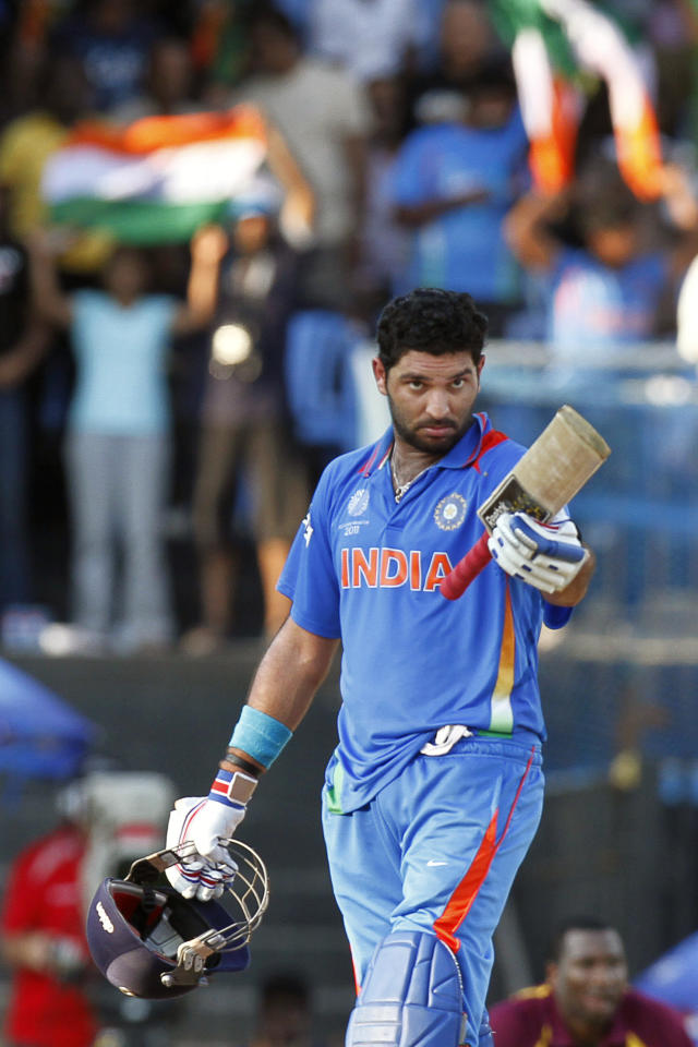 India's Yuvraj Singh acknowledges his century during the Cricket World Cup Group B match between India and West Indies, in Chennai, India, Sunday, March 20, 2011.