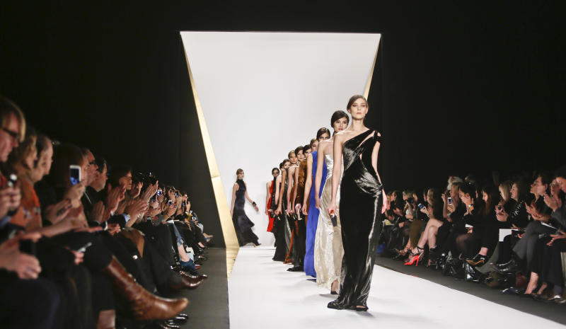 Fashion from the Fall 2013 collection of J. Mendel is modeled on Wednesday, Feb. 13, 2013 in New York.  (AP Photo/Bebeto Matthews)