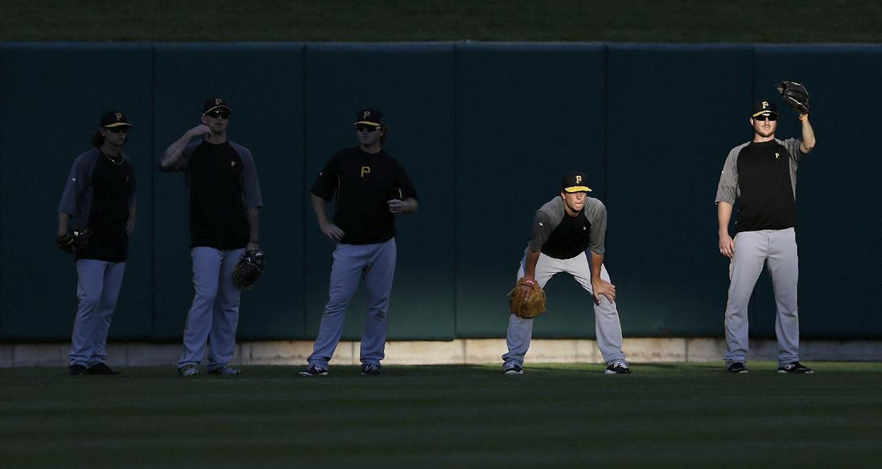 Pittsburgh Pirates watch for fly balls during batting practice before Game 5 of a National League baseball division series between the Pirates and the St. Louis Cardinals on Wednesday, Oct. 9, 2013, in St. Louis. (AP Photo/Jeff Roberson)