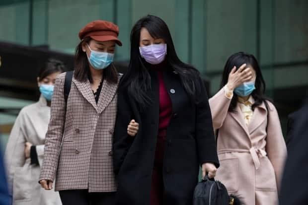Meng Wanzhou is pictured with members of her entourage during a lunch break from BC Supreme Court extradition proceedings.