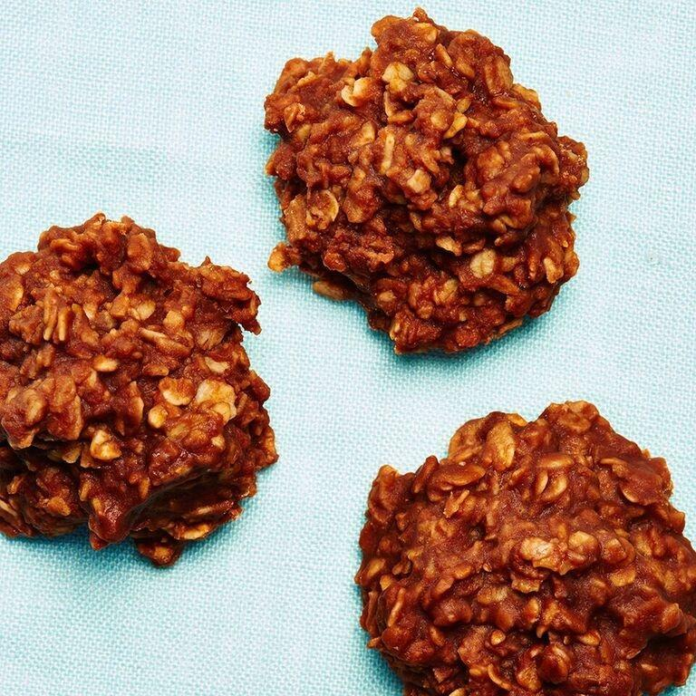 """<strong>Janice's No Bake Cookies</strong><br>Yield: Approximately 36 cookies<br><br><strong>Megan McIntyre:</strong><em> """"I'm a sucker for oatmeal raisin cookies but not too big on actually cooking them – I'm scared of my oven. I'm pretty sure it's hatching nefarious plans to facilitate my demise. So, these no-bake cookies my mom introduced me to are a perfect solution — they've got the oats, plus chocolate and the best part is I don't need to even look at my oven. They look a little grow when you spoon them out on the parchment paper, but believe me, these homely cookies are not only delicious — they're idiot proof. Take it from me.""""</em><br><br><strong>Ingredients</strong><br>2 cup sugar<br>1 stick of margarine<br>4 tbsp cocoa<br>1/2 cup of milk<br>3 cups of oatmeal<br>1 tsp vanilla<br>1/2-1 cup peanut butter<br><br><strong>Instructions</strong><br>1. Boil the sugar, margarine, cocoa, and milk together for 3 minutes, stirring constantly. Do not cook more than 4 minutes!<br><br>2. Remove from heat and add in your oatmeal, vanilla, and peanut butter. You'll have to be quick when you add these three ingredients because as the mixture cools down, it starts to harden so get those ingredients mixed in quick, and then scoop each cookie onto some parchment paper on a baking dish quickly with a spoon.<br><br>3. Scoop cookies on a piece of parchment to set (should set in about 30 minutes).<br><br>4. Store in the fridge to keep them from getting melty if you have a warm kitchen.<span class=""""copyright"""">Photographed by Ted Cavanaugh; Food Styling by Claudia Ficca.</span>"""