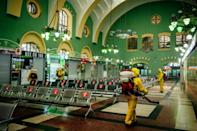 Workers for Russia's emergencies ministry disinfect Kazansky railway station in Moscow, the epicenter of the country's coronavirus outbreak