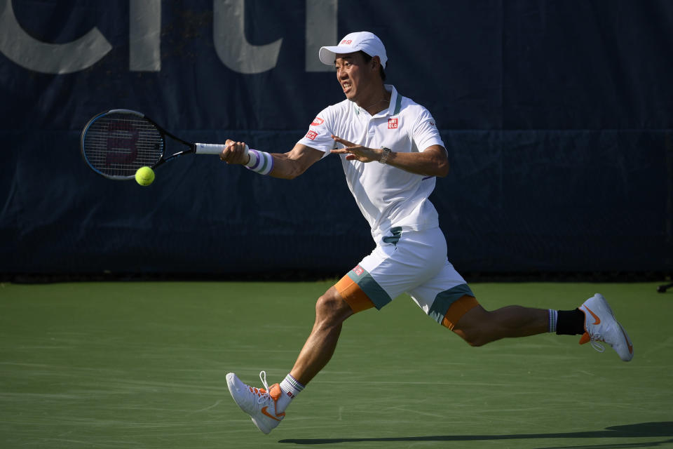 Kei Nishikori, of Japan, hits a running shot against Cameron Norrie, of Britain, during a match in the Citi Open tennis tournament, Thursday, Aug. 5, 2021, in Washington. (AP Photo/Nick Wass)