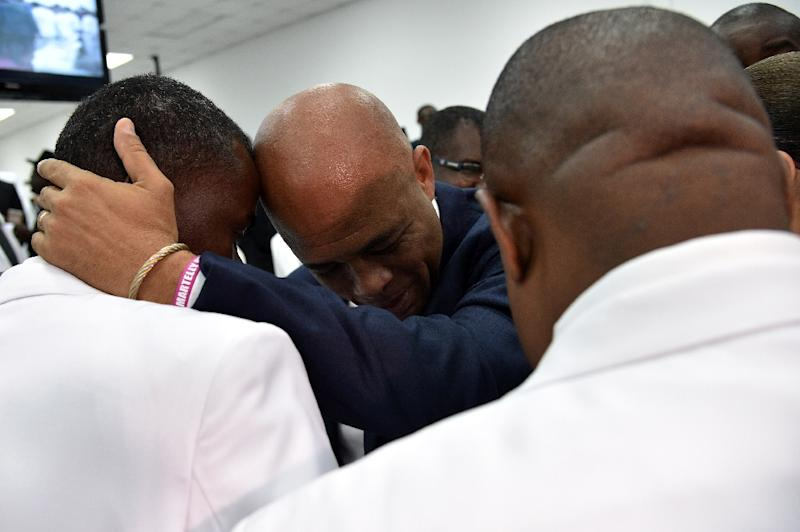 Haitian President Michel Martelly greets Haitian Deputies on February 7, 2016 in Port-au-Prince after Martelly gave his last address to the nation before stepping down as president (AFP Photo/Hector Retamal)