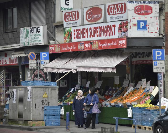 """In this picture taken March 8, 2013, Turkish shops dominate the shopping street in Duisburg-Marxloh, western Germany. Germany's experience with """"guest workers"""" offers lessons for the United States as it debates immigration reform, including whether to provide a path to citizenship for unskilled foreign laborers. (AP Photo/Martin Meissner)"""