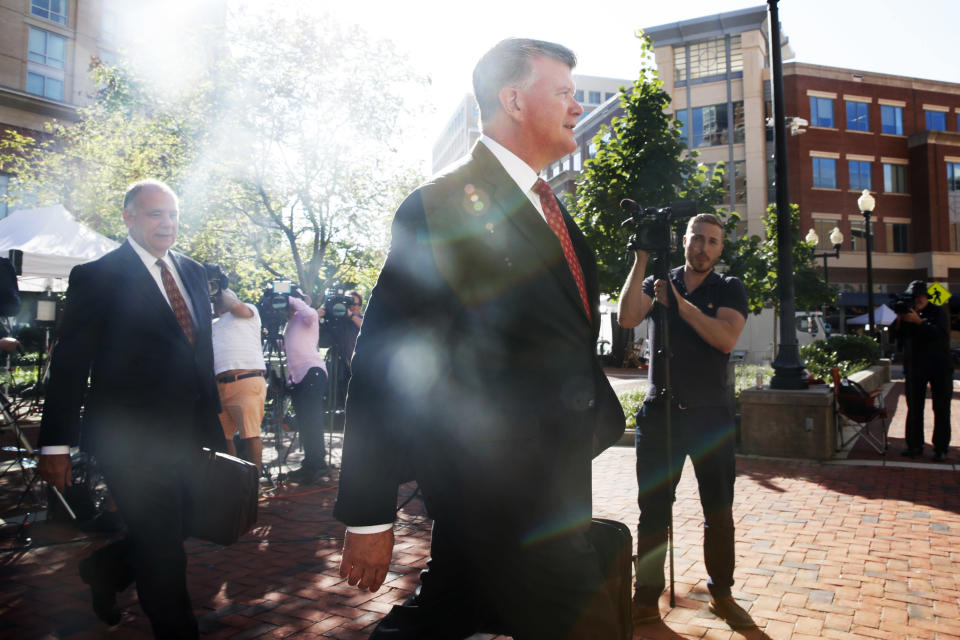 Attorney Thomas Zehnle, left, and Kevin Downing, walk with the defense team for Paul Manafort to federal court as the trial of the former Trump campaign chairman continues, in Alexandria, Va., Tuesday, Aug. 14, 2018. (AP Photo/Jacquelyn Martin)