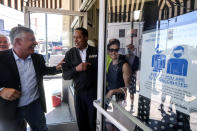 Republican conservative radio show host Larry Elder, second from left, and former Lt. Gov. Abel Maldonado, left, leave after they visiting Philippe The Original Deli during a campaign for the California gubernatorial recall election on Monday, Sept. 13, 2021, in Los Angeles. (AP Photo/Ringo H.W. Chiu)