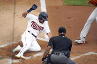 Minnesota Twins' Luis Arraez scores from third base on a wild pitch by Cleveland Indians pitcher J.C. Mejia in the first inning of a baseball game, Thursday, June 24, 2021, in Minneapolis (AP Photo/Jim Mone)