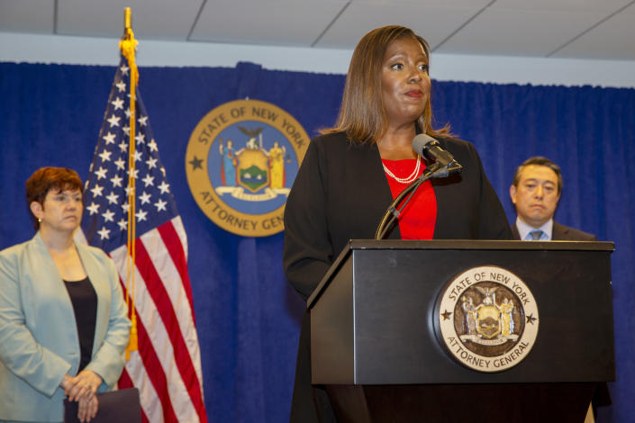 New York State Attorney General Letitia James speaks at a press conference, Tuesday, Aug. 3, 2021, in New York. An investigation found that New York Gov. Andrew Cuomo sexually harassed multiple women in and out of state government and worked to retaliate against one of his accusers, James announced Tuesday. Attorneys Joon Kim, right, and Anne L. Clark, lead investigators, listen. (AP Photo/Ted Shaffrey)