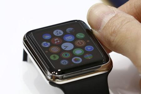 Woman uses Apple Watch on display at electronics store in Tokyo