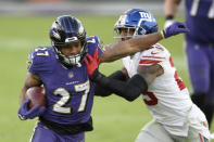Baltimore Ravens running back J.K. Dobbins (27) is pushed out of bounds by New York Giants free safety Logan Ryan (23) during the second half of an NFL football game, Sunday, Dec. 27, 2020, in Baltimore. (AP Photo/Nick Wass)