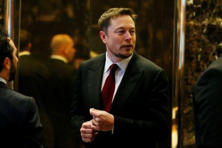 FILE PHOTO: Tesla Chief Executive, Elon Musk enters the lobby of Trump Tower in Manhattan, New York