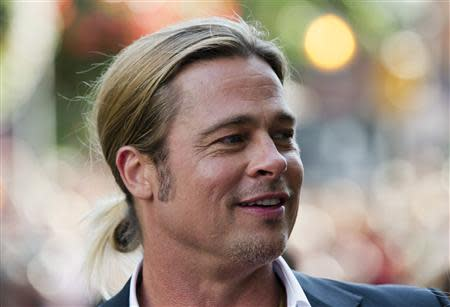 "Actor Brad Pitt arrives for the ""12 Years a Slave"" screening at the 38th Toronto International Film Festival in Toronto"