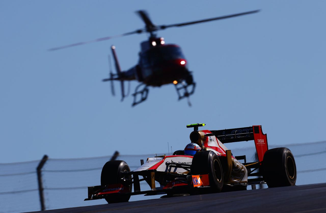 AUSTIN, TX - NOVEMBER 18:  Narain Karthikeyan of India and Hispania Racing Team drives during the United States Formula One Grand Prix at the Circuit of the Americas on November 18, 2012 in Austin, Texas.  (Photo by Paul Gilham/Getty Images)