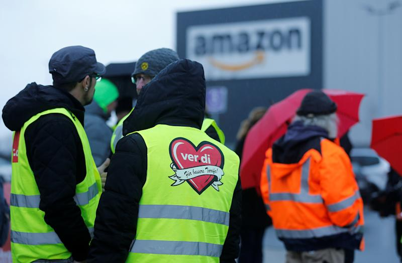 Workers and Verdi Union members are seen during strike action at an Amazon logistics centre in Werne Germany