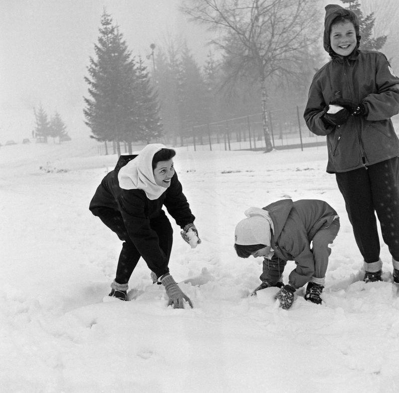 <p>Rita Hayworth has a playful snowball fight with her daughters, Yasmin and Rebecca, in 1956, while on holiday in Megève, a resort town in the French Alps. </p>
