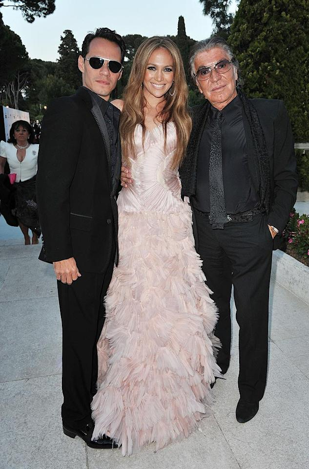 "Jennifer Lopez, ethereal in a Roberto Cavalli Couture silk organza strapless gown, was flanked by her hubby Marc Anthony and the designer himself at the 2010 amfAR Cinema Against AIDS Gala in Cannes, France. Pascal Le Segretain/<a href=""http://www.gettyimages.com/"" target=""new"">GettyImages.com</a> - May 20, 2010"