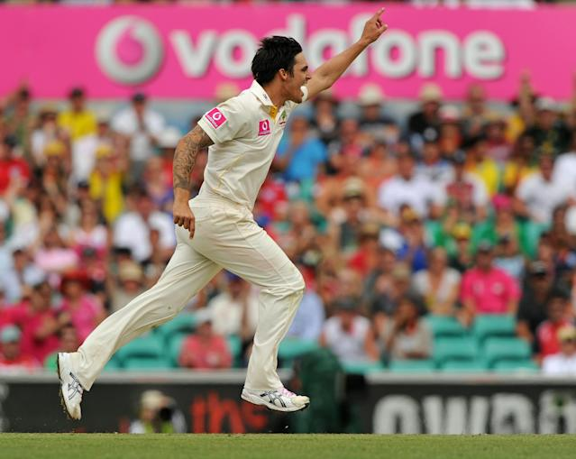 Australian bowler Mitchell Johnson celebrates taking the wicket of England's Jonathon Trott for a duck on day two of the fifth Ashes cricket Test at the Sydney Cricket Ground on January 4, 2011. England were 145-2 chasing the Australian first innings score of 280 as play continued. IMAGE STRICTLY RESTRICTED TO EDITORIAL USE - STRICTLY NO COMMERCIAL USE AFP PHOTO / Greg WOOD (Photo credit should read GREG WOOD/AFP/Getty Images)