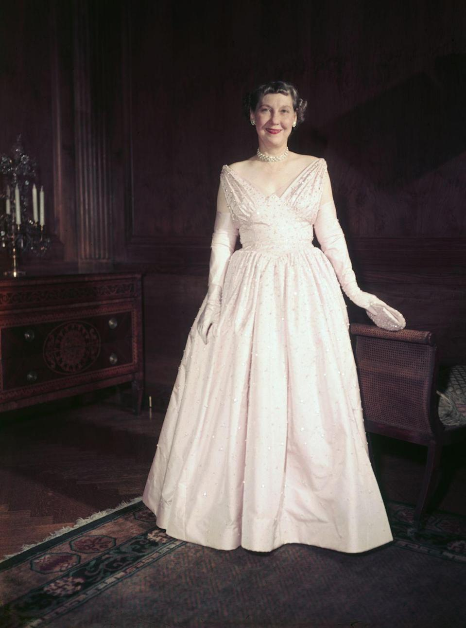 "<p>Mamie Doud Eisenhower wore this <a href=""https://style.time.com/2013/02/18/our-fair-ladies-the-14-most-fashionable-first-ladies/slide/mamie-eisenhower/"" rel=""nofollow noopener"" target=""_blank"" data-ylk=""slk:bubblegum pink shade"" class=""link rapid-noclick-resp"">bubblegum pink shade</a> so much during her time as first lady. It eventually became known as ""Mamie pink"" and was donned by most women in the '50s and early '60s.</p>"