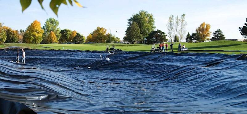 Large pond liner over a pond in a park