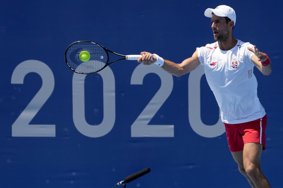Novak Djokovic, of Serbia, practices for the men's tennis competition at the 2020 Summer Olympics, Thursday, July 22, 2021, in Tokyo. (AP Photo/Charlie Riedel)