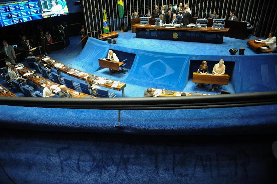 Graffiti reading 'Temer out!' is seen in the gallery of the Brazilian Senate during a voting session of the committee deciding on the impeachment of suspended President Dilma Rousseff, in Brasilia, on August 9, 2016 (AFP Photo/Andressa Anholete)