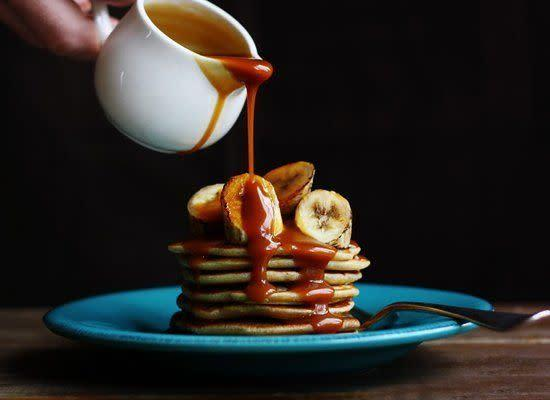 "<strong>Get the <a href=""http://www.citrusandcandy.com/2012/02/coconut-pancakes-bananas-salted-caramel.html"" rel=""nofollow noopener"" target=""_blank"" data-ylk=""slk:Coconut Pancakes with Grilled Bananas and Salted Caramel Rum Sauce recipe"" class=""link rapid-noclick-resp"">Coconut Pancakes with Grilled Bananas and Salted Caramel Rum Sauce recipe</a> from Citrus and Candy</strong>"