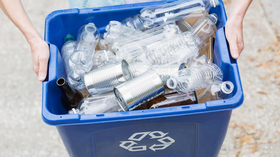 taking recycling bin out to the curb for collection