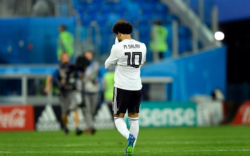 Not fit: Mo Salah was a forlorn figure as his Egypt side went down 3-1 to the hosts - AP