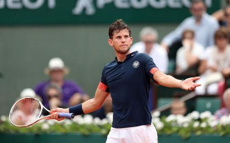 FILE PHOTO: Tennis - French Open - Roland Garros, Paris, France - June 10, 2018 Austria's Dominic Thiem reacts during the final against Spain's Rafael Nadal REUTERS/Pascal Rossignol/File Photo