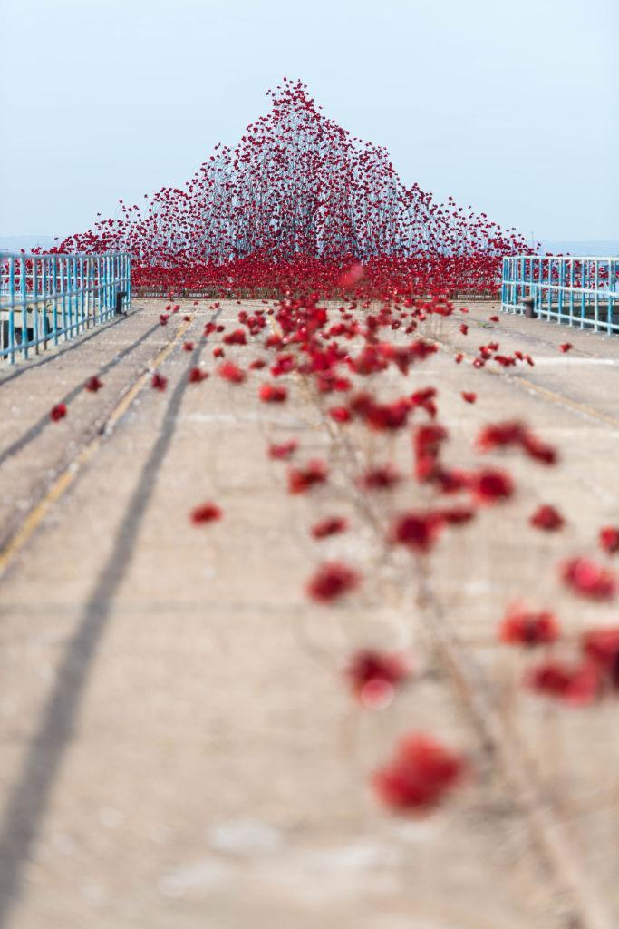 """<p>The poppy sculpture """"Wave"""" at stretches along the Barge Pier in Southend-on- Sea. (Getty Images) </p>"""