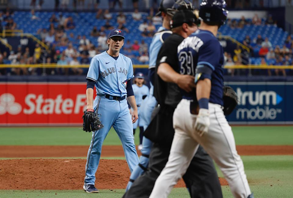 Sep 22, 2021; St. Petersburg, Florida, USA; Toronto Blue Jays pitcher Ryan Borucki (56)  reacts after he throws a pitch that hits Tampa Bay Rays center fielder Kevin Kiermaier (39) during the eighth inning at Tropicana Field. Mandatory Credit: Kim Klement-USA TODAY Sports - 16806188