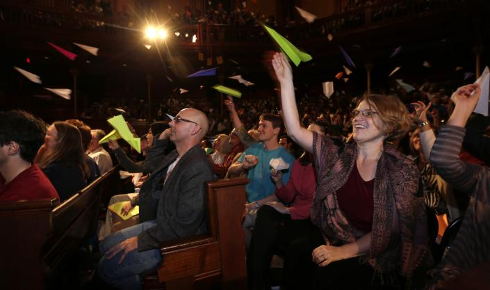 Audience members throw paper airplanes during a performance at the Ig Nobel Prize ceremony at Harvard University, in Cambridge, Mass., Thursday, Sept. 20, 2012. The Ig Nobel prize is an award handed out by the Annals of Improbable Research magazine for silly sounding scientific discoveries that often have surprisingly practical applications. (AP Photo/Charles Krupa)