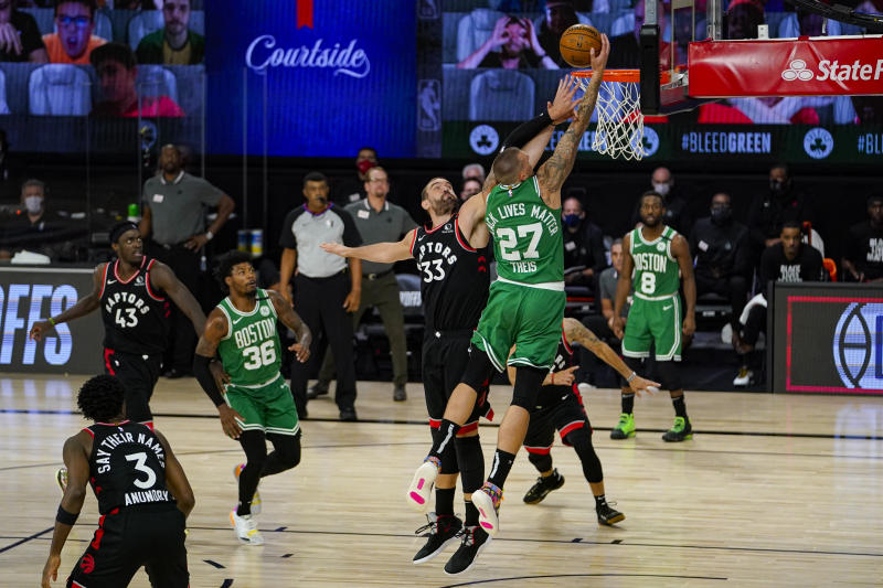 Boston Celtics center Daniel Theis (27) shoots over Toronto Raptors center Marc Gasol (33) during the second half of an NBA conference semifinal playoff basketball game Wednesday, Sept. 9, 2020, in Lake Buena Vista, Fla. (AP Photo/Mark J. Terrill)