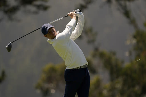 Rory McIlroy of Northern Ireland, watches his tee shot on the fourth hole during the second round of the PGA Championship golf tournament at TPC Harding Park Friday, Aug. 7, 2020, in San Francisco. (AP Photo/Jeff Chiu)