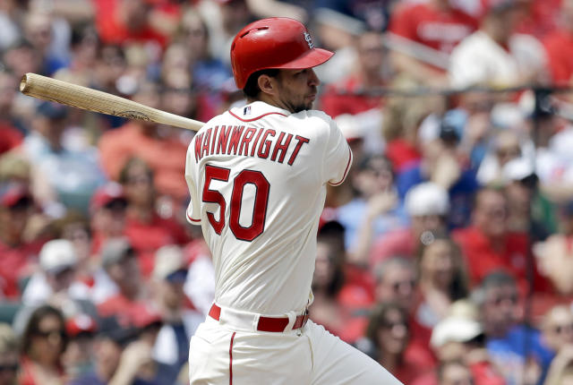 St. Louis Cardinals' Adam Wainwright hits an RBI single during the second inning of a baseball game against the Chicago Cubs, Saturday, April 12, 2014, in St. Louis. (AP Photo/Jeff Roberson)