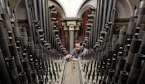 <p>Organ Tuner Chris Wintle at work in the organ loft of Canterbury Cathedral in Kent, as he tunes one of over 3000 pipes in the loft which make up the organ in time for the Christmas services. (PA) </p>