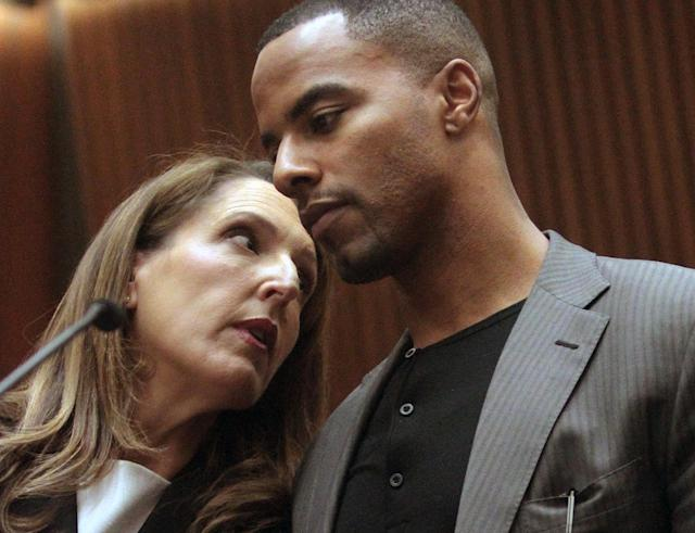 Former NFL safety Darren Sharper, right, huddles with attorney Blair Berk in Los Angeles Superior Court on Thursday, Feb. 20, 2014, in Los Angeles. Sharper has pleaded not guilty to charges that he drugged and raped two women he met at a West Hollywood night club. (AP Photo/Los Angeles Times, Bob Chamberlin, Pool)