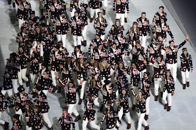 Athletes from the United States wave to spectators as they arrive during the opening ceremony of the 2014 Winter Olympics in Sochi, Russia, Friday, Feb. 7, 2014. (AP Photo/Robert F. Bukaty)