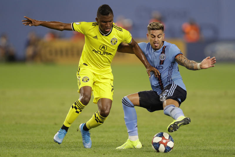 New York City FC defender Ronald Matarrita, right, tries to keep the ball from Columbus Crew midfielder Luis Diaz during the second half of an MLS soccer match Wednesday, Aug. 21, 2019, in New York. NYCFC won 1-0. (AP Photo/Kathy Willens)