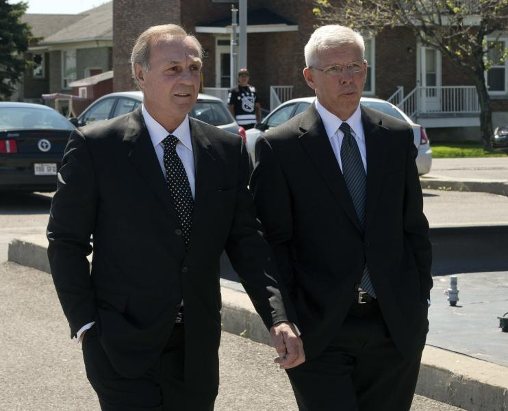 Former Montreal Canadiens' Guy Lafleur, left, and Rejean Houle arrive for funeral service's for France St. Louis, mother of New York Rangers hockey player Martin St. Louis, Sunday, May 18, 2014 in Laval, Quebec. (AP Photo/The Canadian Press, Ryan Remiorz)